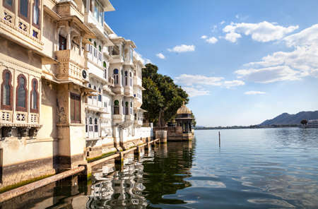 residential houses: Lake Pichola with residential houses at cloudy sky in Udaipur, Rajasthan, India