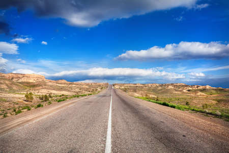 desert highway: Highway road in the desert and cloudy blue sky Stock Photo
