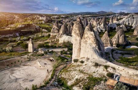 geological formation: Horses near tufa geological formation called fairy chimneys at sunrise in Cappadocia, Turkey Stock Photo