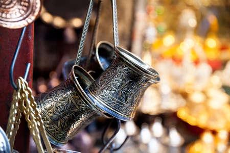tea set: Copper Turkish coffee pot at Istanbul market Stock Photo