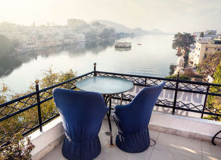 honeymoon: Roof top restaurant with beautiful view to Lake Pichola in the morning in Udaipur, Rajasthan, India Stock Photo