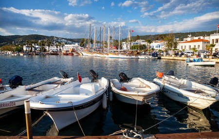 motor boats: BODRUM, TURKEY - MAY 25, 2016: Famous Marina Harbor with motor boats and Yachts at sunset Editorial