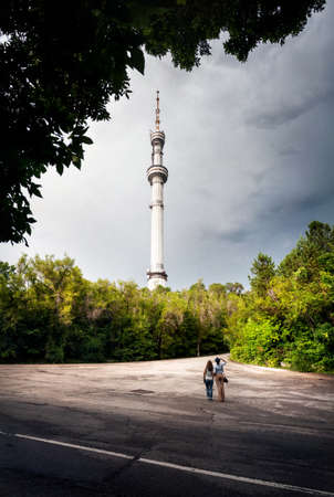 road of love: Two friends tourist looking at TV tower Kok-Tobe  in Almaty Kazakhstan Editorial
