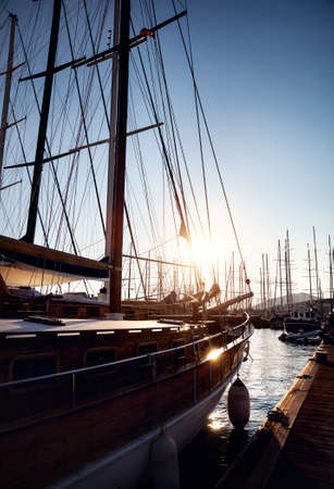 siluet: Harbor with boats in Aegean Sea in tropical Bodrum at sunset, Turkey Stock Photo