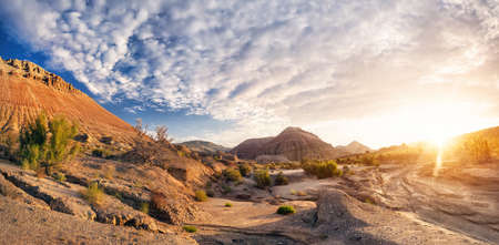 desert landscape: Altyn Emel National Park with Aktau mountains at beautiful sunset in Kazakhstan