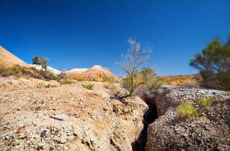 soil erosion: Altyn Emel National Park with Aktau Mountains at blue sky in Kazakhstan