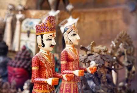 India, Rajasthan, Rajastan, Indian, Jodhpur, Jaipur, Jaisalmer, doll, puppet, woman, man, king, queen, dress, red, yellow, theatre, marionette, blue, symbol, face, tribal, bazar, bazaar, market, Mughal, religion, souvenir, shop, flea, art, asia, asian, cr Stock Photo