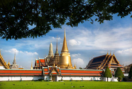 Temple of the Emerald Buddha Wat Phra Kaew with Golden Stupa in Bangkok at sunset