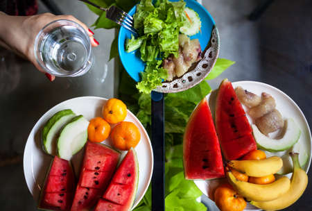 Plate with watermelon, banana, oranges and salad in restaurant in Thailand