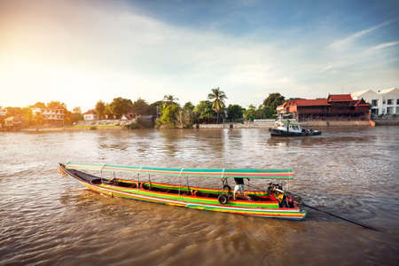 Longtail boat cruise by Chao Phraya river in Ancient city Ayutthaya, Thailand