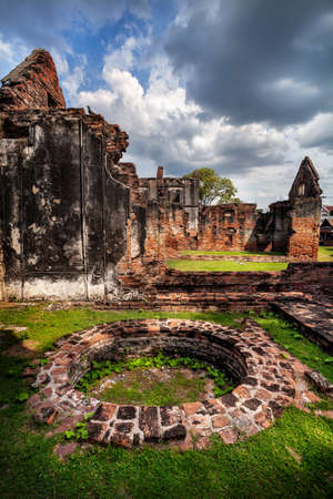 fasade: Ancient ruined walls and well of Temple in Lopburi at sunset sky, Thailand
