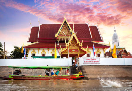 discovery channel: Aythaya, Thailand - November 20, 2016: Tourist near Thai Temple at cruise by Long tail boat on Chao Phraya River