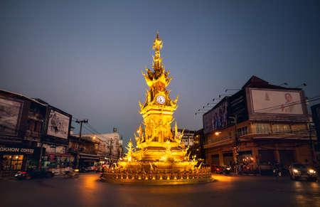 CHIANG RAI, Thailand - November 25, 2016: Golden clock tower with illumination, established in 2008 by Thai visual artist Chalermchai Kositpipatat at night.