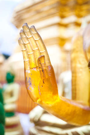 saint: Hand of Buddha in mudra from yellow stone in Wat Doi Suthep, Ciang Mai, Thailand