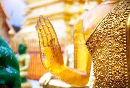 Hand of Buddha in mudra from yellow stone in Wat Doi Suthep, Ciang Mai, Thailand