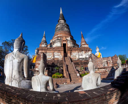 Big Stupa and Buddha statues in Wat Yai Chai Mongkol monastery in Ayuttaya, Thailand Stock Photo
