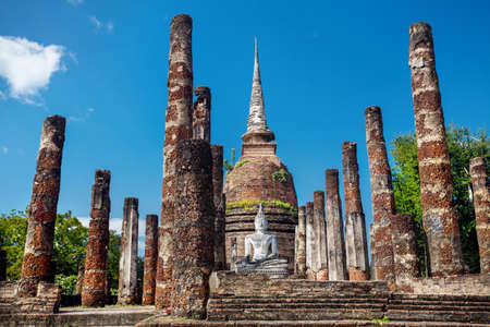 Ancient White Buddha and Stupa surround by ruined column in Wat Sa Si of Sukhothai Historical Park, Thailand