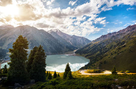Mountain highland lake and forest at sunrise in Almaty, Kazakhstan