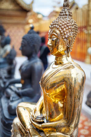 Golden Buddha statue in Wat Doi Suthep, Ciang Mai, Thailand Stock Photo
