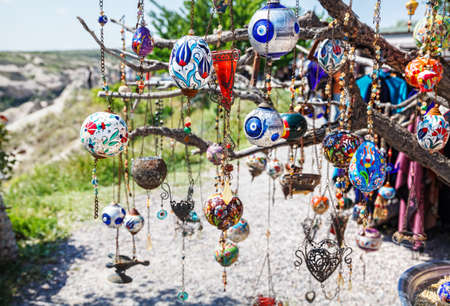 lucky charm: Evil eyes and balloons on the tree in Goreme Panorama Cappadocia, Turkey