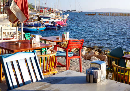 restaurant tables: Colorful chairs and tables in seaside restaurant of Bodrum, Turkey