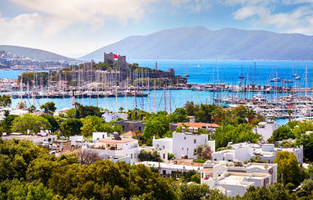 View of Bodrum castle and Marina Harbor in Aegean sea in Turkey