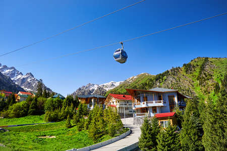 Cable car and cottages in the mountain ski resort Chimbylak in Almaty, Kazakhstan