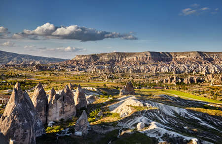 Beautiful landscape of ancient geological formation called fairy chimneys at sunset in Cappadocia valley, Turkey
