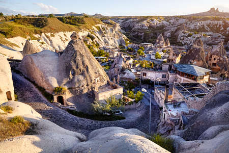 Hotels and resort in the Tufa Mountains at sunset in Goreme city, Cappadocia, Turkey