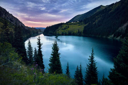 Beautiful view of high mountain lake Kolsai at sunset in Kazakhstan, central Asia