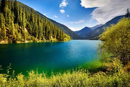 Beautiful view of high mountain lake Kolsai at summertime in Kazakhstan, central Asia
