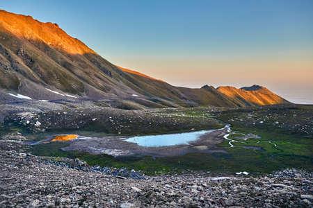 Landscape of Mountain Lake with river reflection at sunrise sky background Reklamní fotografie