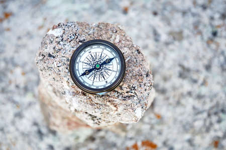 Round Vintage Compass on the stone background. Travel and adventure concept. Stock Photo