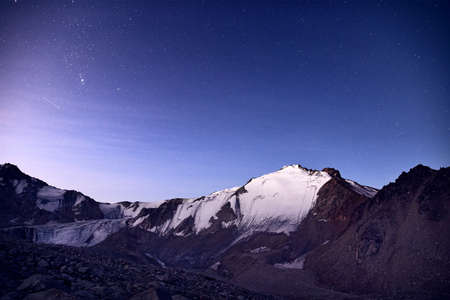 Snowy mountains under blue night sky full of stars in the Kazakhstan Reklamní fotografie