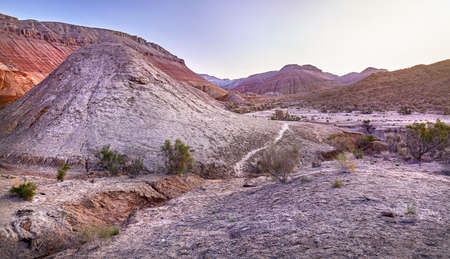 Panorama of Altyn Emel National Park with Aktau Mountains at beautiful purple sunrise in Kazakhstan