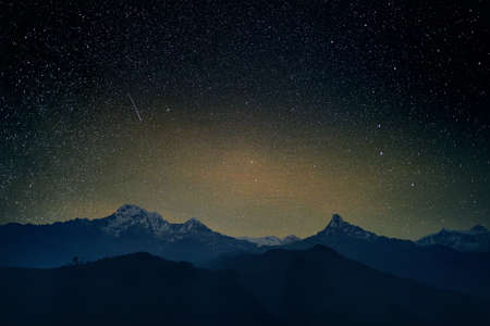 Night starry sky and mountain range of Annapurna, Nepal Stock Photo