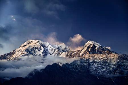 Snowy Annapurna mountain range at night starry sky in Nepal  Stock Photo