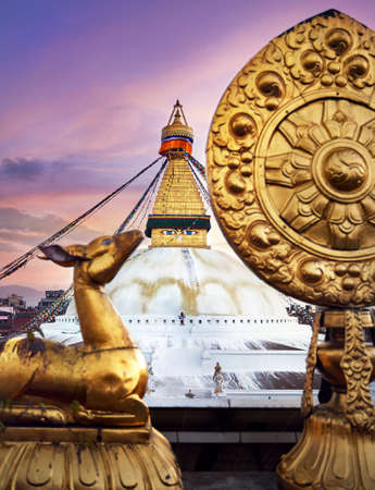 View of Bodnath Buddhist Stupa and Golden deers with leaf at the roof of monastery in Kathmandu Stock Photo