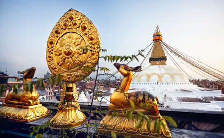 View of Bodnath Buddhist Stupa and Golden deers with leaf at the roof of monastery in Kathmandu Editorial