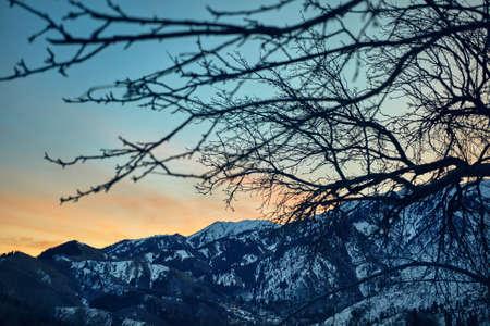 Pink sunrise in beautiful mountain range of Zaili Alatay from Kok Zhaylau trail in Almaty, Kazakhstan