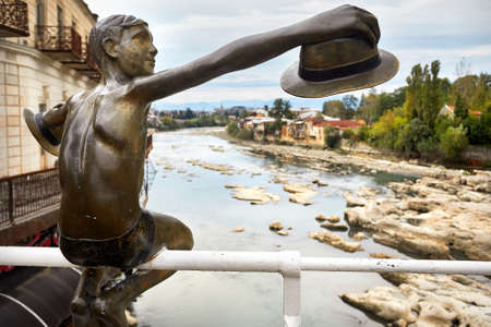Sculpture of Boy with hat on the bridge in the central Kutaisi, Georgia