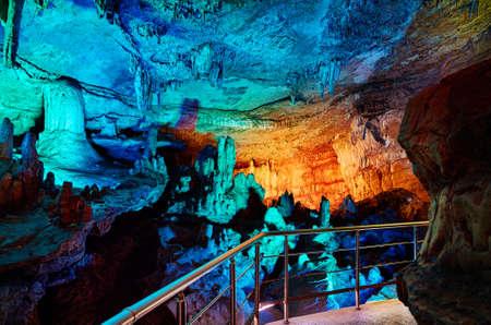 Underground cave Sataplia with colorful illumination in Kutaisi, Georgia