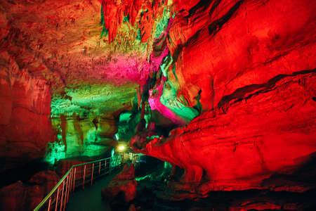 Underground cave Sataplia with colorful red illumination in Kutaisi, Georgia