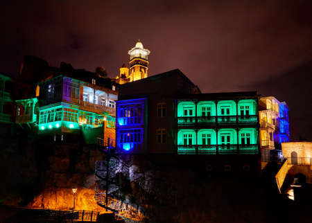 Narikala fortress and Public Sulfuric bath with colorful lighting at night in central Tbilisi, Georgia