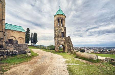 Bell Tower in front of Bagrati church at overcast sky in Kutaisi, Georgia 版權商用圖片