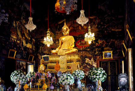Golden Buddha statue in the hall of temple in Bangkok, Thailand