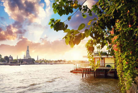 Beautiful view of Wat Arun and Chao Phraya River at sunset in Bangkok, Thailand