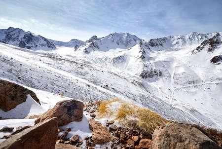 Panoramic view of high mountain range of Zaili Alatay in Almaty, Kazakhstan