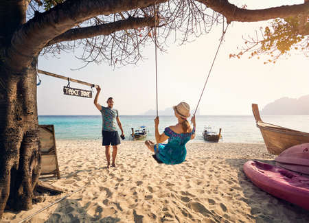 Happy couple on the tropical beach of Phi Phi island in Southern Thailand. Travel magazine concept. Stock Photo