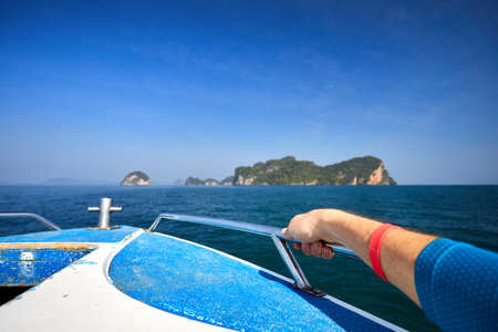 Tourist at speedboat on the tropical islands in Andaman Sea, Thailand Stock Photo